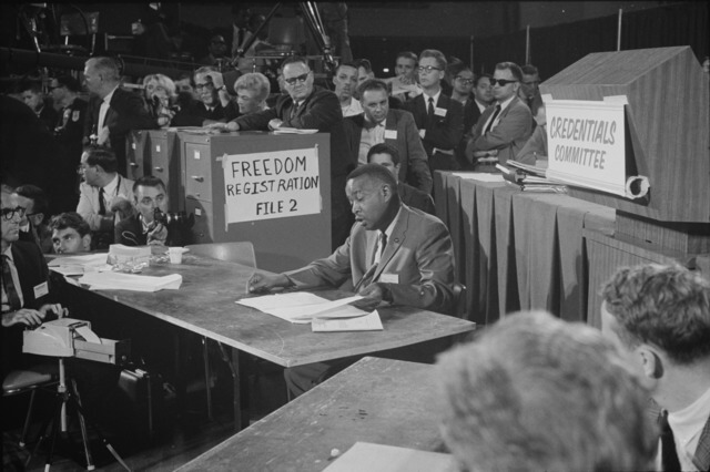 Aaron Henry, chair of the Mississippi Freedom Democratic Party delegation, speaks before the Credentials Committee at the Democratic National Convention, Atlantic City, New Jersey, August 22, 1964. Photograph by Warren K. Leffler. Courtesy of the Library of Congress Prints and Photographs Division, loc.gov/pictures/item/2003688166.