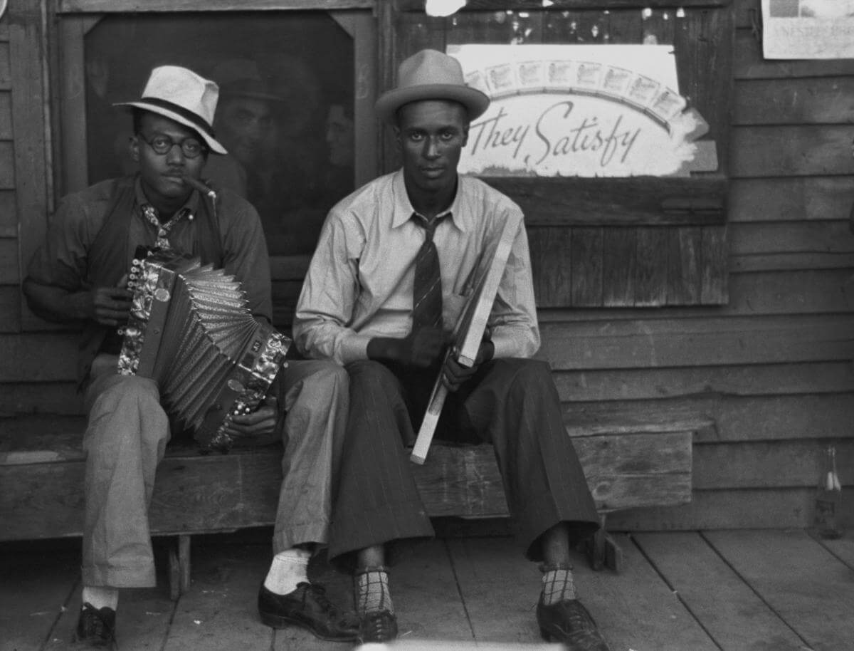 Negro musicians playing accordion and washboard in front of store, near New Iberia, Louisiana, 1938. Photograph by Russell Lee. Courtesy of Farm Security Administration/Office of War Information Black-and-White Negatives. Library of Congress Prints and Photographs Division Washington, DC.