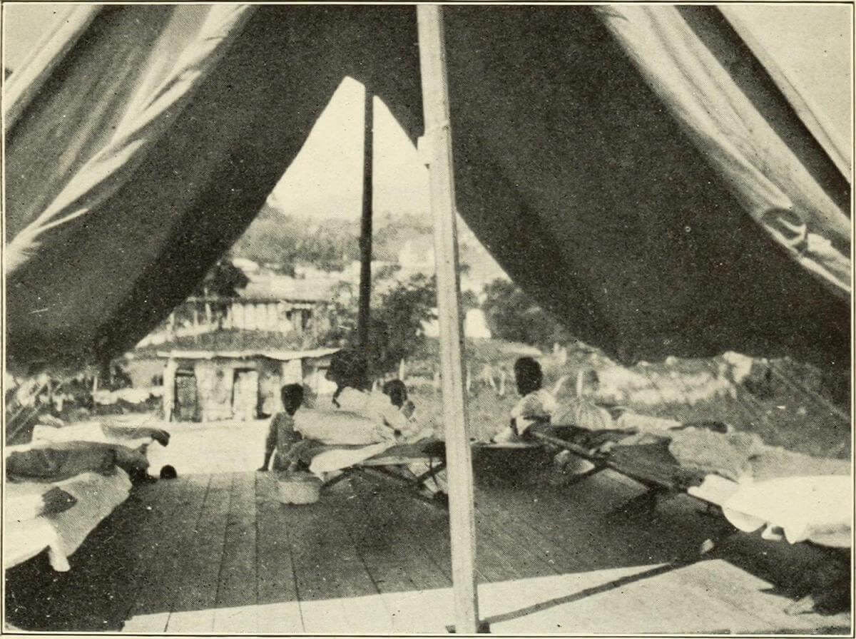 Interior of Hospital Tent, Puerto Rico, 1911. Originally published in Bailey K. Ashford and Pedro Guitérrez Igaravidez's Uncinariasis (Hookworm disease) in Porto Rico: a medical and economic problem (Washington DC: US Government Print Office, 1911). Photograph uploaded by Flickr user Internet Archive Book Images. Image is in public domain.