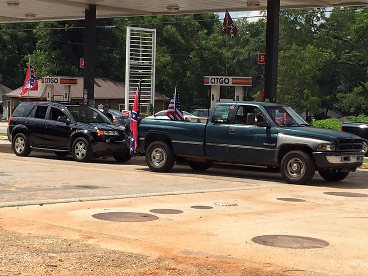 Mark Auslander, Confederate flag ralliers at gas station, Monroe, Georgia, 2015.