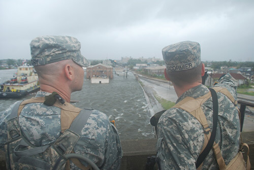 Chuck Simmins, Louisiana National Guardmen observe as water from the industrial canal overtops the levees, New Orleans, Louisiana, September 2008.
