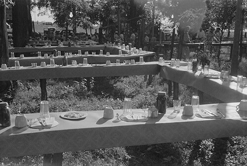 Marion Post Wolcott, Table in picnic grove set for St. Thomas church supper, near Bardstown, Kentucky, August 7, 1940. Library of Congress Prints and Photographs Division, FSA/OWI Black & White Negatives Collection, LC-USF33-030983-M5.