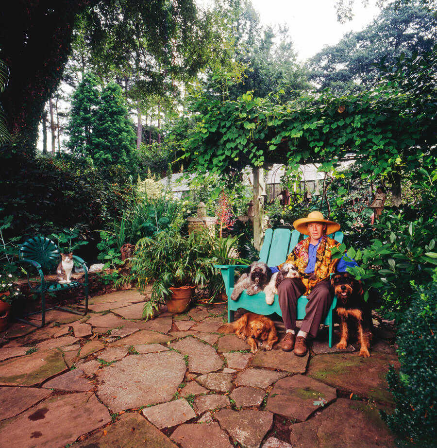 Ryan Gainey in his garden with his pets, Decatur, Georgia, ca. 1993. Photograph by David Schilling.