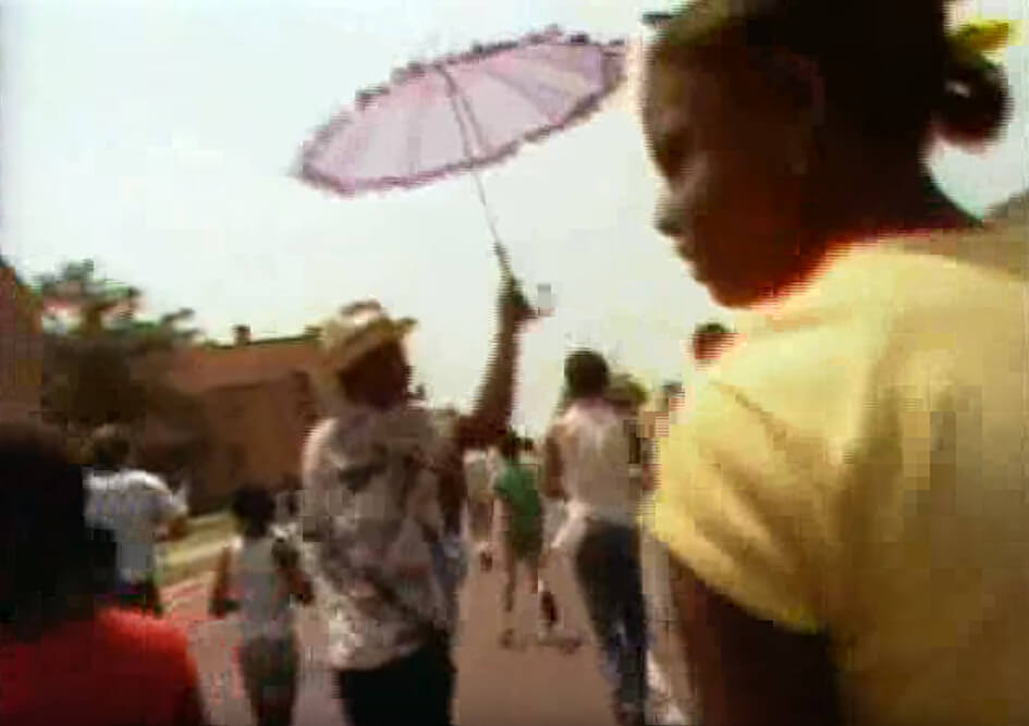 Spyboys singing at the 66th Annual Zulu Parade, New Orleans, Lousiana, May 1982. Footage by Alan Lomax and crew. Courtesy of Alan Lomax YouTube archive. Screenshot by Southern Spaces.