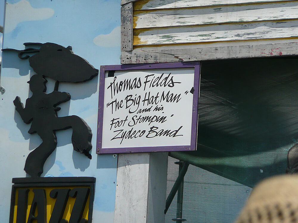 "Thomas Fields' ""The Big Hat Man"" and his Foot Stompin' Zydeco Band sign, New Orleans Jazz and Heritage Festival, New Orleans, Louisiana, April 25, 2009. Photograph by Flickr user Rocky A. Creative Commons license CC BY-NC-ND 2.0."