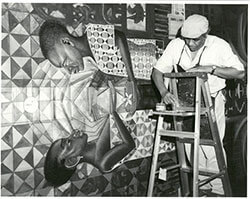 John Biggers paints House of the Turtle, Hampton University, Hampton, Virginia, ca. 1990. Photo courtesy of John Biggers's Estate. John Biggers Papers, Emory University Manuscript, Archives, and Rare Book Library.