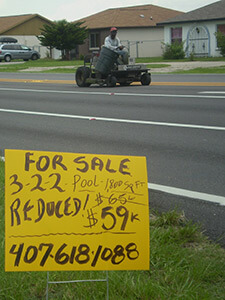For Sale sign, Buenaventura Lakes, Florida, 2010. Photograph by Simone Delerme.