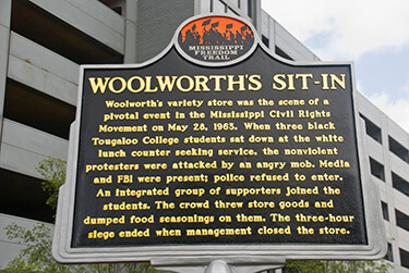 Woolworth's Sit-In Historic marker, a plaque in downtown Jackson, Mississippi, dedicated May 28, 2013. Photograph by Ron Cogswell. Courtesy of Ron Cogswell. CC BY 2.0