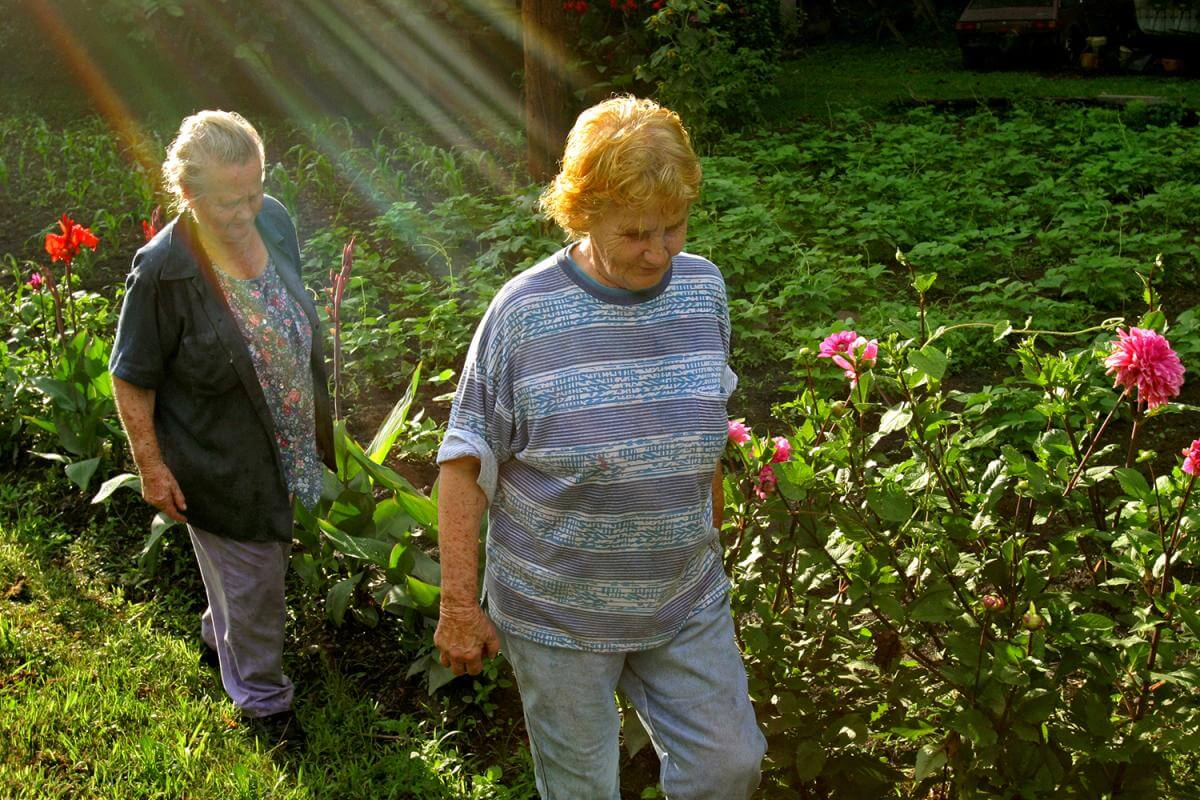 Sisters, in the glory of their garden. Letcher County, KY, 2005.