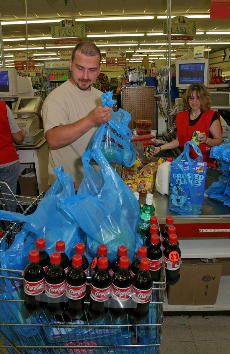 Coal miner buys groceries for his family at Buffalo Creek Supermarket. Logan County, WV, 2005.