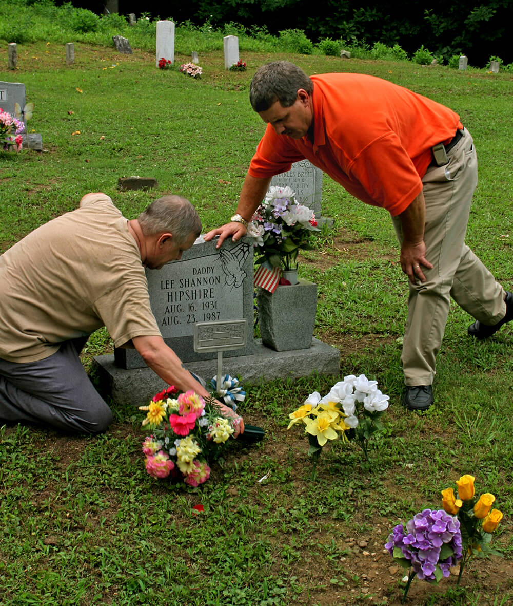 Sons attend the grave of their father, Lee Hipshire, a coal miner and black lung victim. Logan County, WV, 2005.