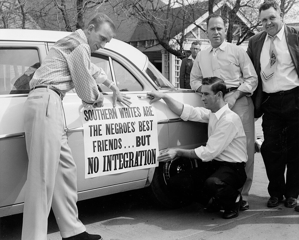 Desegregation opponents decorate a car for a protest parade, Nashville, TN, March 1956. © Nashville Public Library.​​