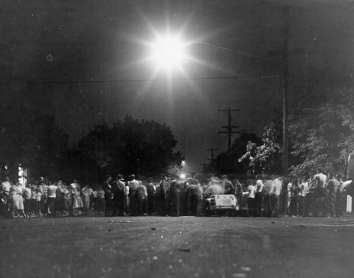 Crowd in the street near Hattie Cotton after the bombing, Nashville, TN, September 1957. © Nashville Public Library.​​