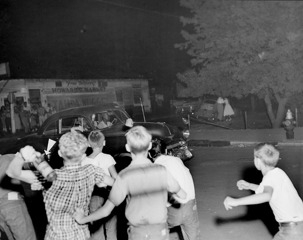 Young demonstrators throw bottles, Nashville, TN, September 1957. © Nashville Public Library.​​