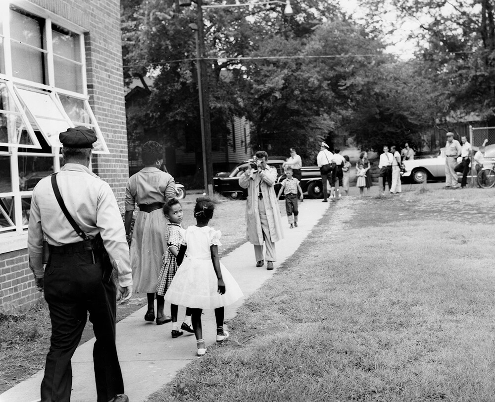 Mother and children leaving Glenn School, Nashville, TN, September 1957. © Nashville Public Library.​​