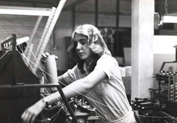Blonde Woman Working in a Textile Plant, Tennessee, circa late 1970s. Courtesy of Special Collections and Archives, Georgia State University Library, Southern Labor Archives, Amalgamated Clothing and Textile Workers Union, Memphis-Jackson Joint Board Records, L1992_11_112.