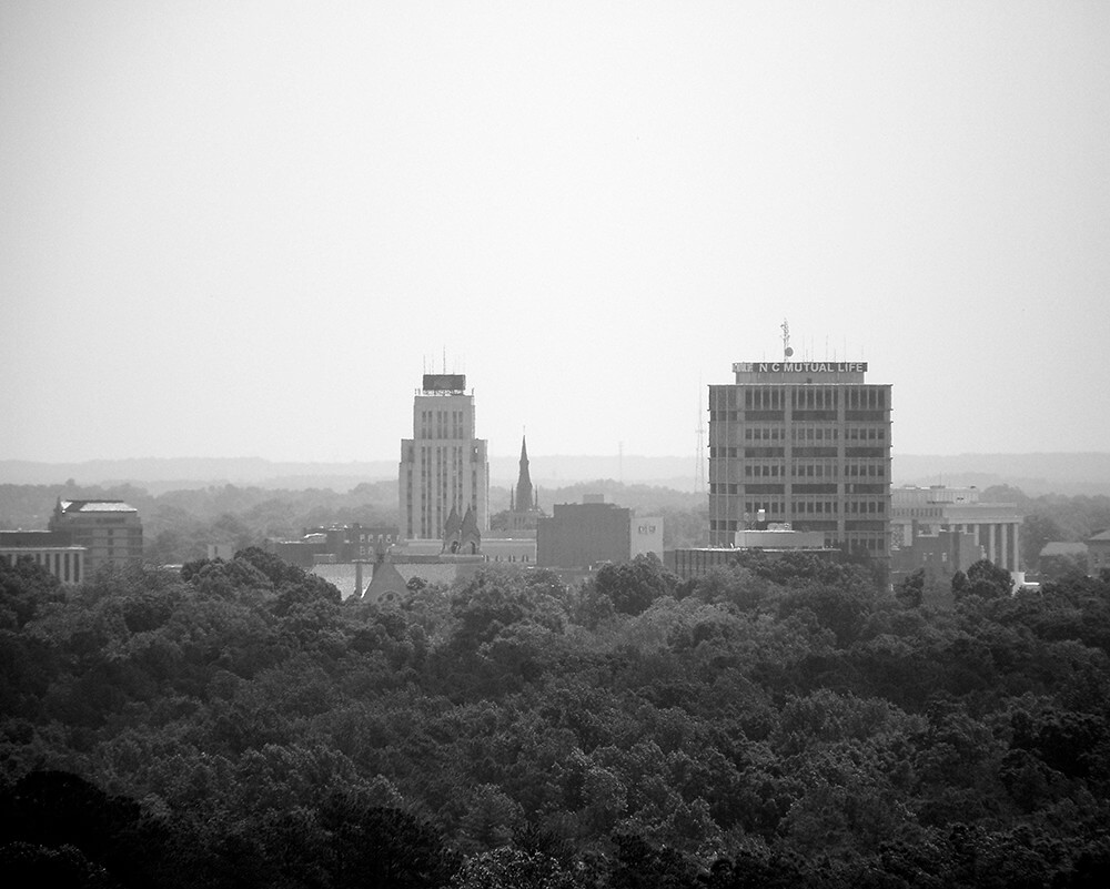 Downtown Durham (through the haze). Photograph by Flickr user bullcitydave, May 15, 2008. Courtesy of bullcitydave. CC BY-NC-ND 2.0.