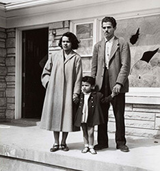 Andrew Wade and his wife and daughter stand in front of their damaged house, May 16, 1954, from the Louisville Courier-Journal. Reproduced by permission from the Wisconsin Historical Society.