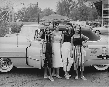 Four young African American women standing before a convertible automobile, Carr's Beach, Maryland, ca. 1958. Used with permission from WANN Radio Station Records, Archives Center, National Museum of American History, Smithsonian Institution, AC0800-0000005.