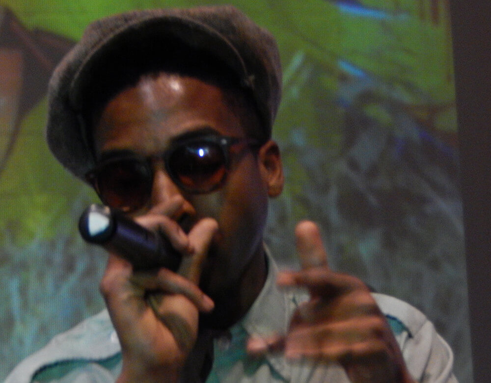 Atlanta rap artist Jack Preston takes the stage at Gallery 72, Atlanta, Georgia, October 18, 2015. Photograph by Clint Fluker. Courtesy of LiFT Art Salon.