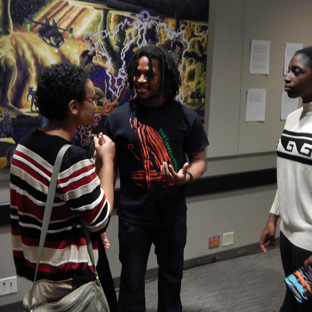LiFT artist Tim Short discusses his artwork with two event attendees, Gallery 72, Atlanta, Georgia, October 18, 2015. Photograph by Clint Fluker. Courtesy of LiFT Art Salon.