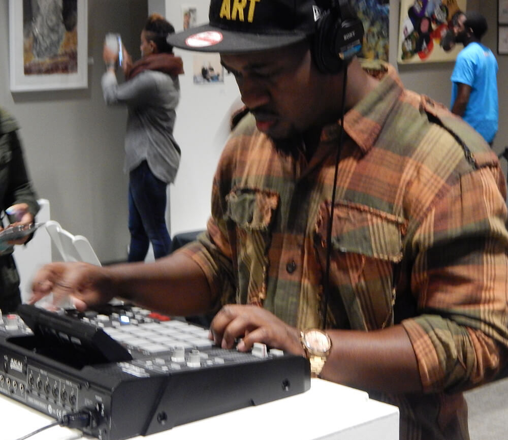 LiFT attendee Mikey P interacts with a series of beat machines from different eras of hip hop, Gallery 72, Atlanta, Georgia, October 18, 2015. Photograph by Clint Fluker. Courtesy of LiFT Art Salon.