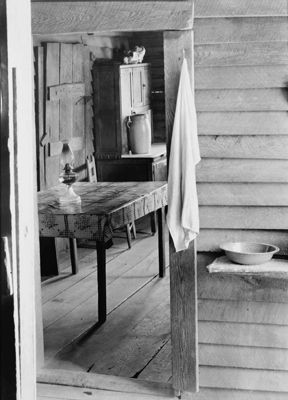 Washstand in the dog run and kitchen of Floyd Burroughs' cabin. Hale County, Alabama, 1935 or 1936. Photographic negative by Walker Evans. Courtesy of Library of Congress Prints and Photographs Division, FSA/OWI Black-and-White Negatives Collection, LC-USF342-008133.