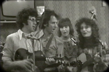 The Strange Creek Singers perform at Onllwyn Miners' Welfare Hall in Onllywyn, South Wales, 1976. Video still from Keep Your Eye upon the Scale, by Tom Hansell, Patricia Beaver, and Angela Wiley.