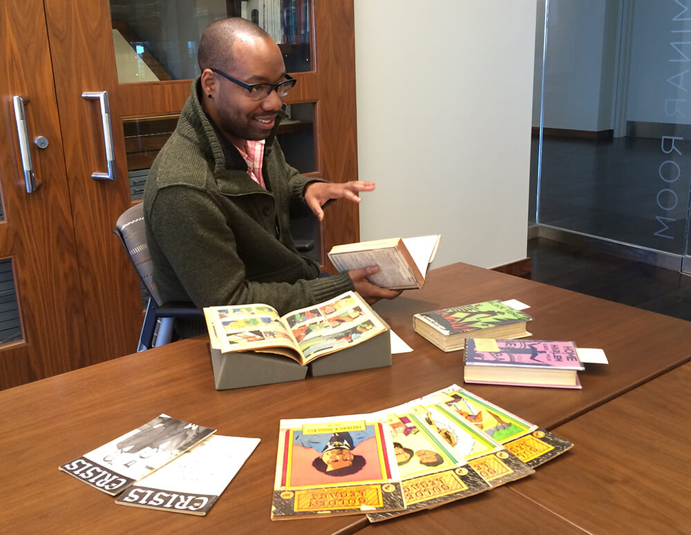 Clint Fluker exploring archival materials at Emory University's Stuart A. Rose Manuscript, Archives, and Rare Book Library, March 29, 2016. Photograph by Kelly Gannon. Courtesy of Kelly Gannon.