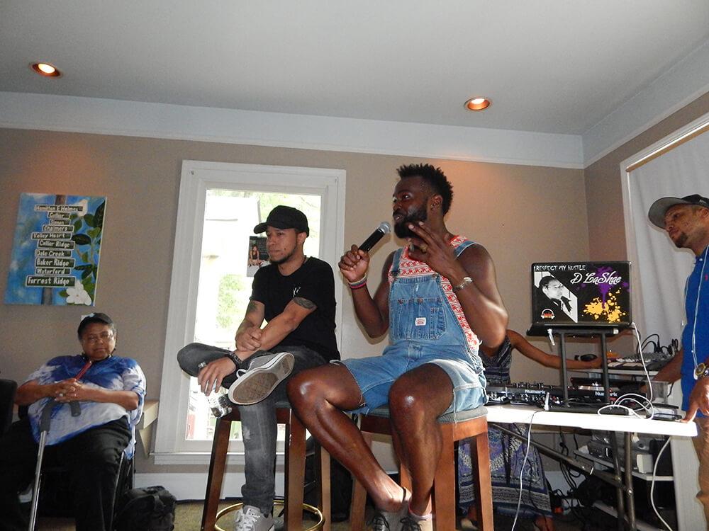 WERC Crew speaks to the crowd, Atlanta, Georgia, July 12, 2015. Photograph by Clint Fluker. Courtesy of LiFT Art Salon.