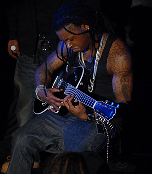 Lil Wayne plays the guitar, Washington, DC, January 15, 2008. Photograph by Flickr user Georgetown Voice. Courtsey of Georgetown Voice, Creative Commons License CC-BY-NC-SA 2.0.