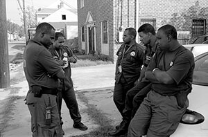 New Orleans police officers, off St. Claude Avenue. New Orleans, Louisiana, October 2005. Photograph by Lewis Watts. Courtesy Lewis Watts.