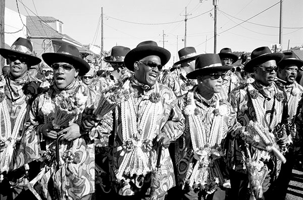 Lundi Gras second line, St. Claude Avenue. New Orleans, Louisiana, 2011. Photograph by Lewis Watts. Courtesy of Lewis Watts.