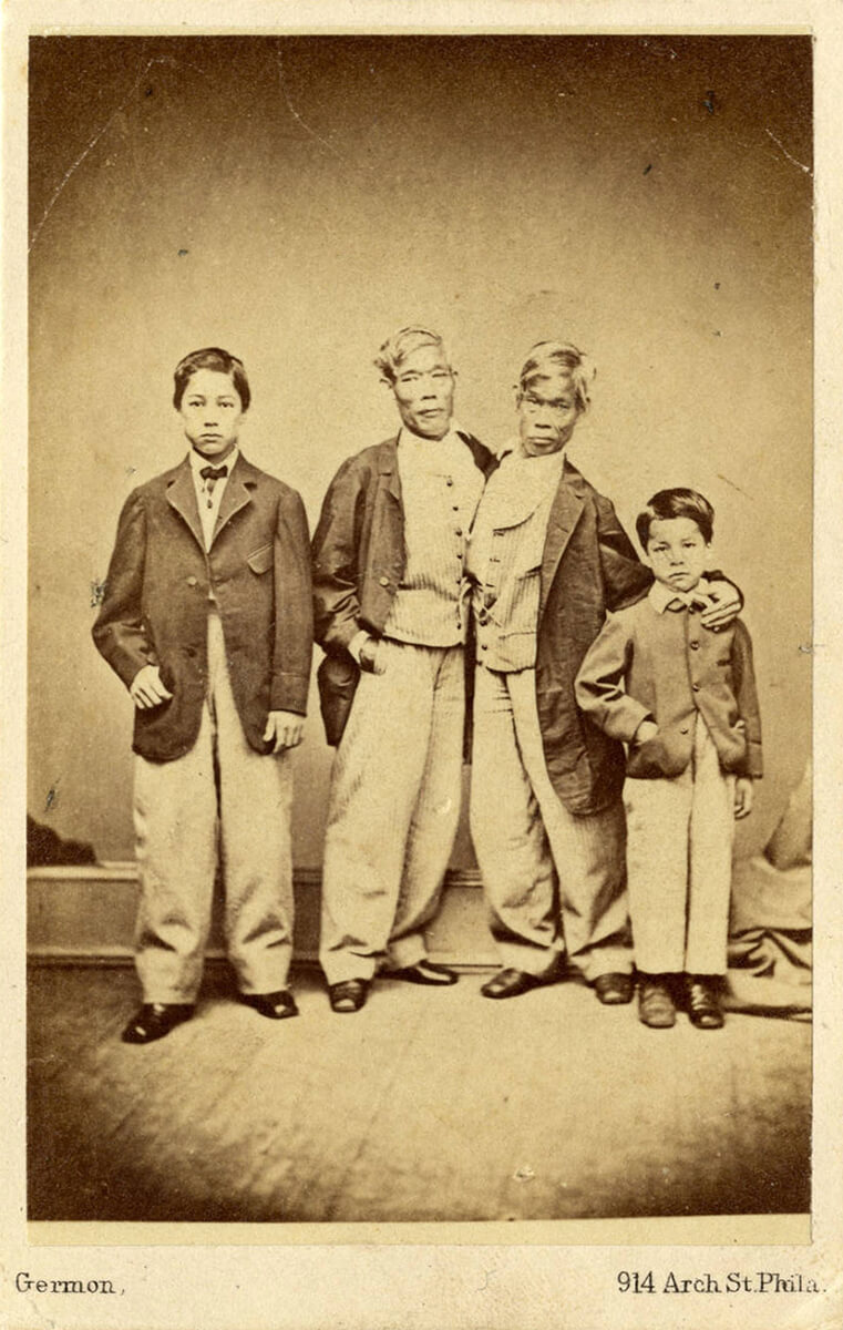 Patrick Henry Bunker, Eng Bunker, Chang Bunker, and Albert Bunker, ca. 1860–1870. Photograph by Washington Lafayette Germon. Photograph courtesy of the North Carolina Collection Photographic Archives, Louis Round Wilson Special Collections Library, University of North Carolina at Chapel Hill.
