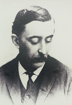 Portrait of Lafcadio Hearn, 1889. Photograph by Fredrick Gutekunst. From The Lafcadio Hearn Library, University of Toyama Central Library.