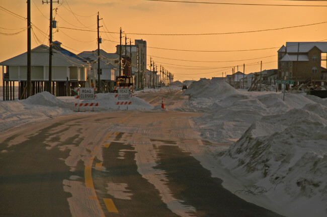 Marvin Nauman, Roads covered with sand, Navarre Beach, Florida, 2005, photograph courtesy of FEMA.