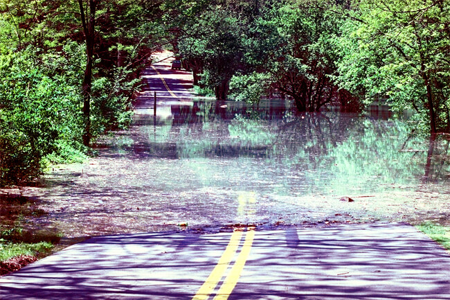 David Schwab, High water on access road, Grafton, West Virginia, 1987, Courtesy of the Army Corps of Engineers.