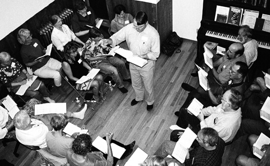 Laurie Kay Sommers, David Lee leads a singing school in a private home as part of the Rocky Mountain Sacred Harp Convention, Boulder, Colorado, September 26, 2003.