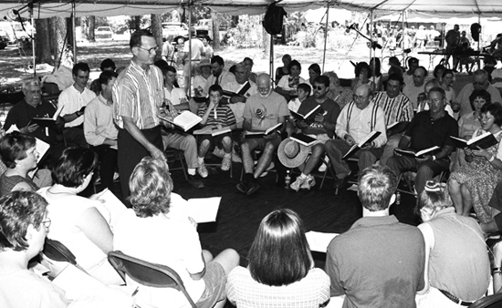 Laurie Kay Sommers, D. Johnny Lee leads at the Silas Lee Memorial Sacred Harp Sing, Florida Folk Festival, White Springs, Florida, 2000.