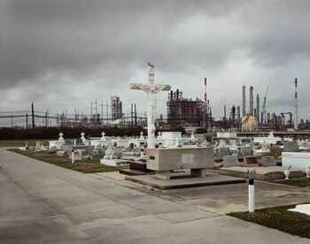 Richard Misrach, Holy Rosary Cemetery and Dow Chemical Corporation (Union Carbide Complex), Taft, Louisiana, 1998 from Petrochemical America, photographs by Richard Misrach, Ecological Atlas by Kate Orff (Aperture, 2012). © Richard Misrach, courtesy of Pace/MacGill Gallery, New York; Fraenkel Gallery, San Francisco; and Marc Selwyn Gallery, Los Angeles.