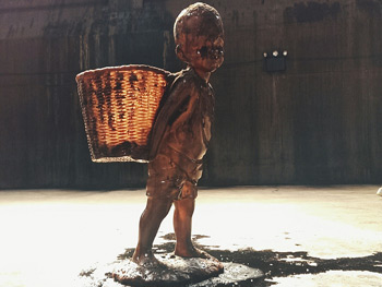 Child carrying basket inside Kara Walker's A Subtlety, Brooklyn, New York, June 15, 2014. Photograph by B. C. Lorio. Courtesy of B. C. Lorio.