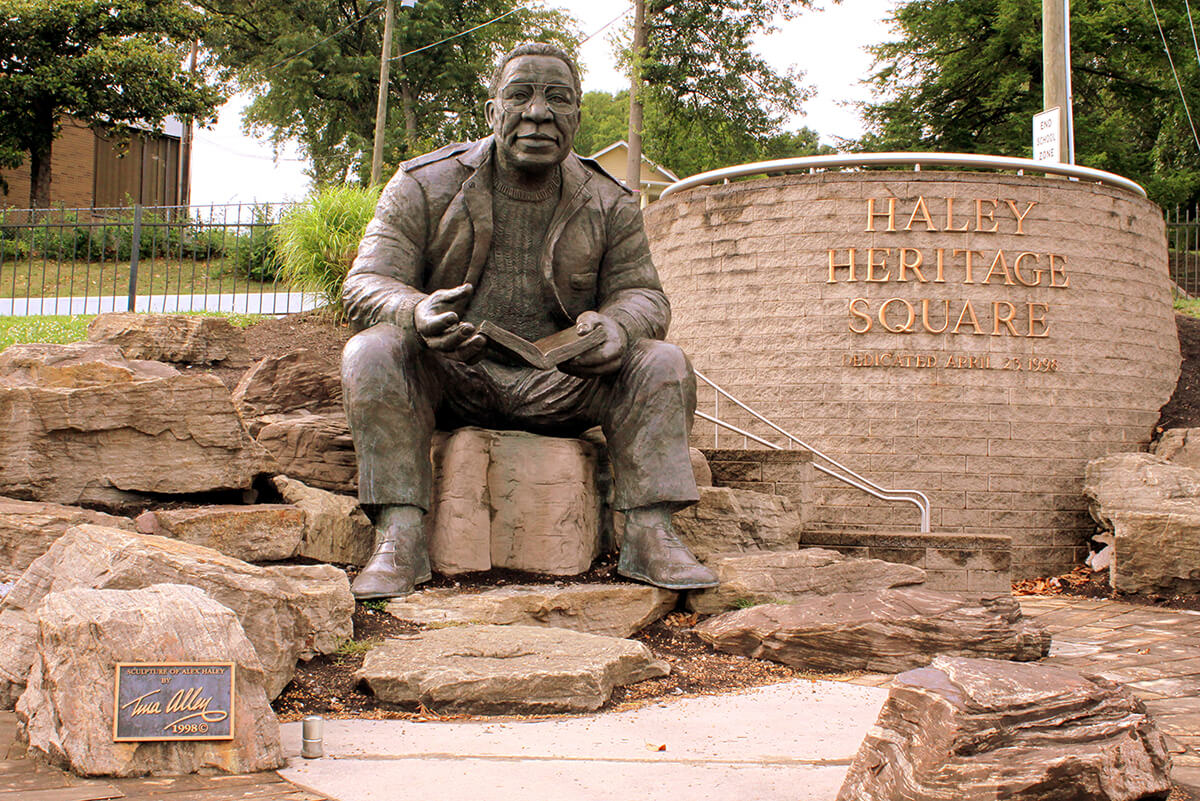 Statue of Roots author Alex Haley in Haley Heritage Square, Knoxville, Tennessee, June 21, 2014. Photograph by Flickr user Brent Moore. Creative Commons license CC BY-NC 2.0.