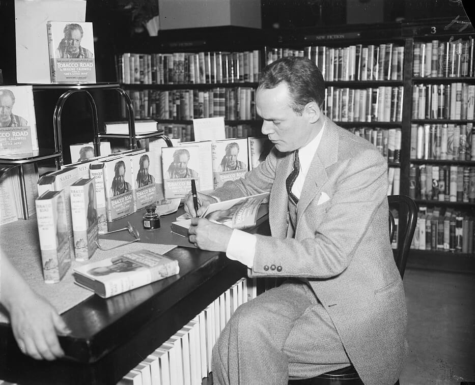 Erskine Caldwell signing copies of Tobacco Road, ca. April, 1936. Photograph by George Harris and Martha Ewing. Courtesy of the Library of Congress Prints and Photographs Division, loc.gov/resource/hec.40683.