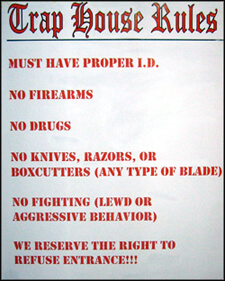 """""""Trap House Rules,"""" sign posted outside a nightclub on Columbia Dr, Decatur, Georgia. Photograph by Matt Miller, 2007. Courtesy of Matt Miller."""