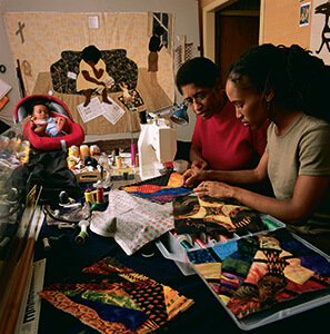 Gwen Magee at work with her daughter Kamili Magee Hemphill and Grandson Ellington Hemphill. Photo courtesy of Roland L. Freeman, 2014.