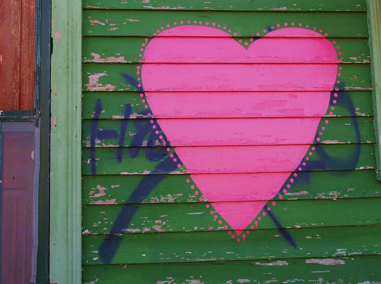Faubourg St. John, New Orleans, Louisiana, 2005. Photograph by Cynthia Scott. A heart almost obliterates an offending X on Maurepas Street. © Cynthia Scott.