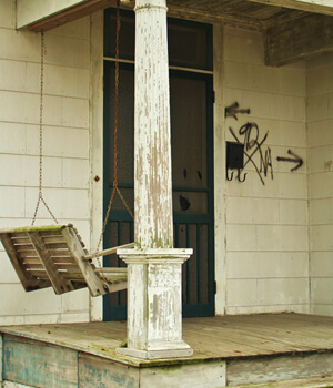 Porch Swing, 1232 Moss Street, Faubourg St. John, New Orleans, Louisiana, 2010. Photograph by Cynthia Scott. © Cynthia Scott.