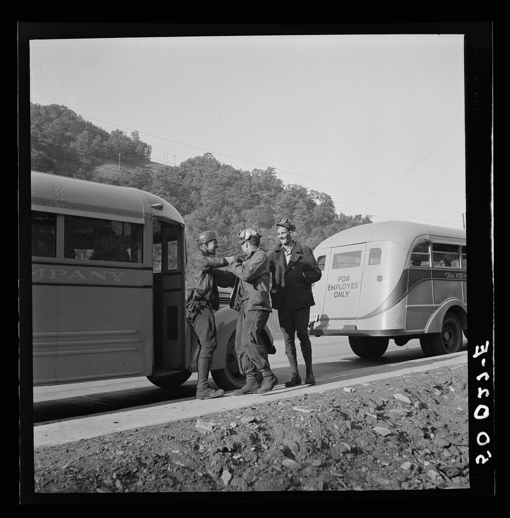 Coal miners waiting along road for bus to take them home, Bluefield section of Welch, West Virginia, 1938. Photograph by Marion Post Wolcott. Courtesy of the Library of Congress Prints and Photographs Division, loc.gov/pictures/item/2017799287.