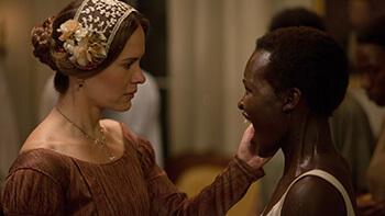 Sarah Paulson as Mistress Epps and Lupita Nyong'o as Patsey, 2013. © FoxSearchlight.