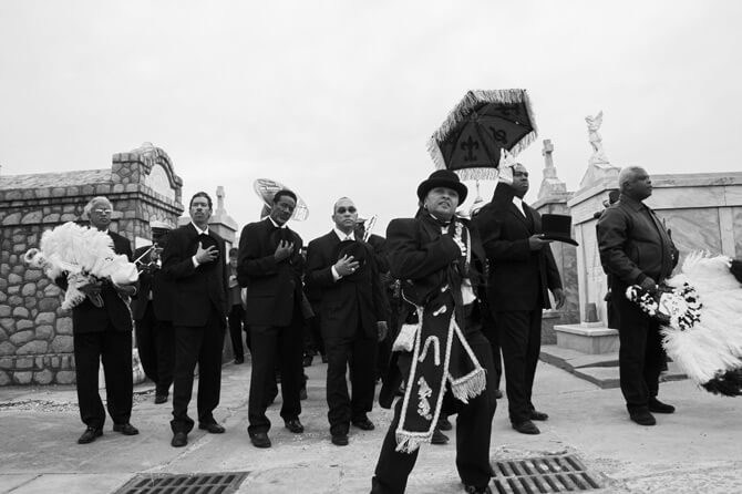 """Black Men of Labor Lead Doc Paulin's Jazz Funeral,"" New Orleans, Louisiana, November 25, 2007. Photograph by Derek Bridges."
